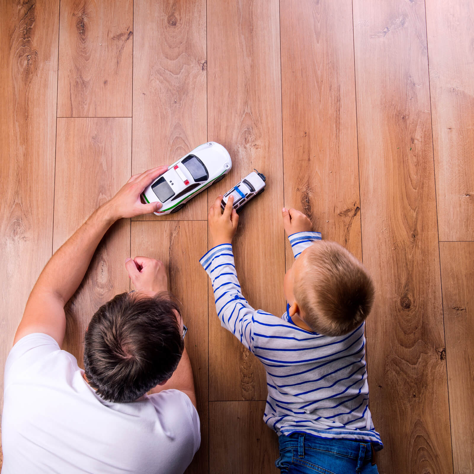 Father and kid playing with toycar   IQ Floors