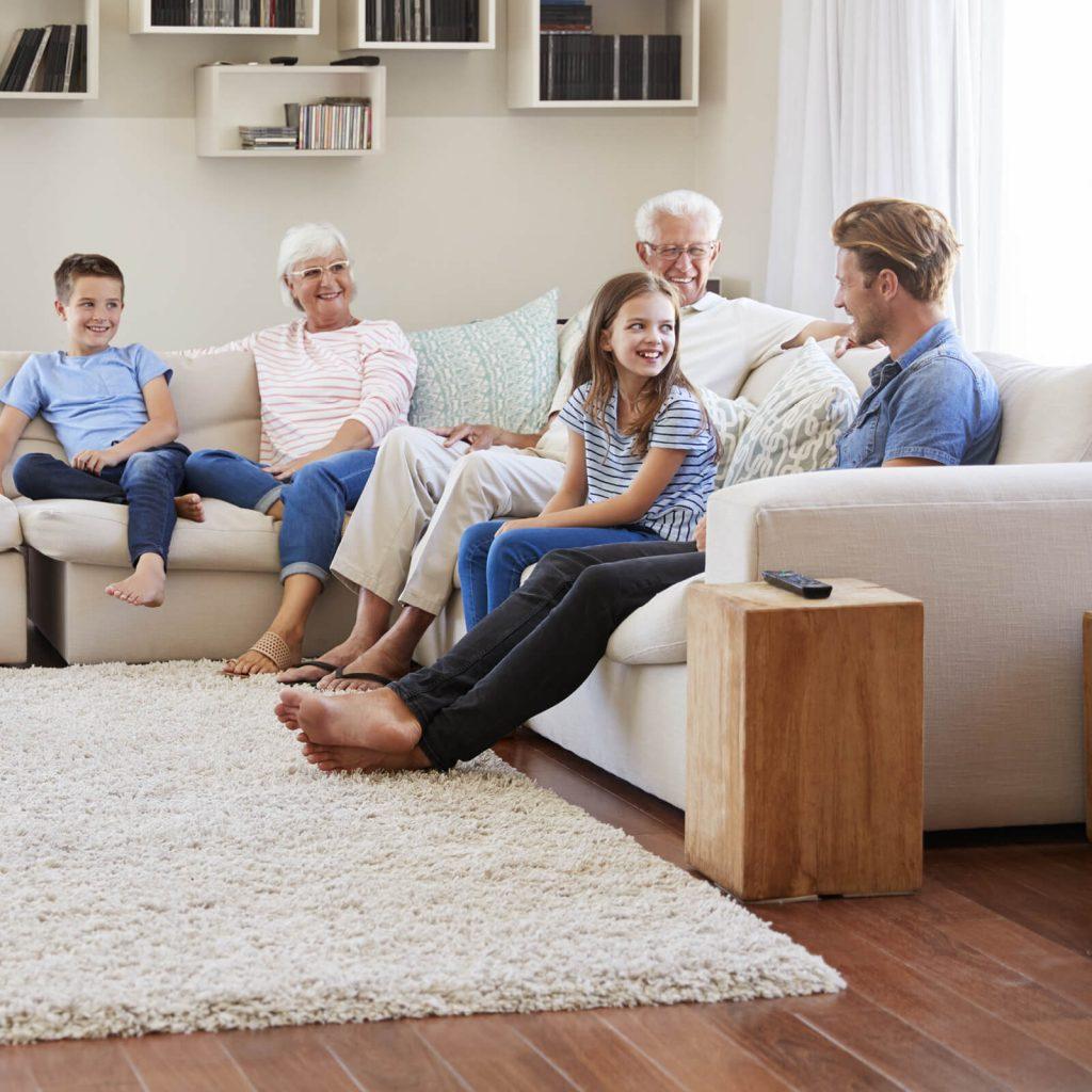 Family gosping in living room | IQ Floors