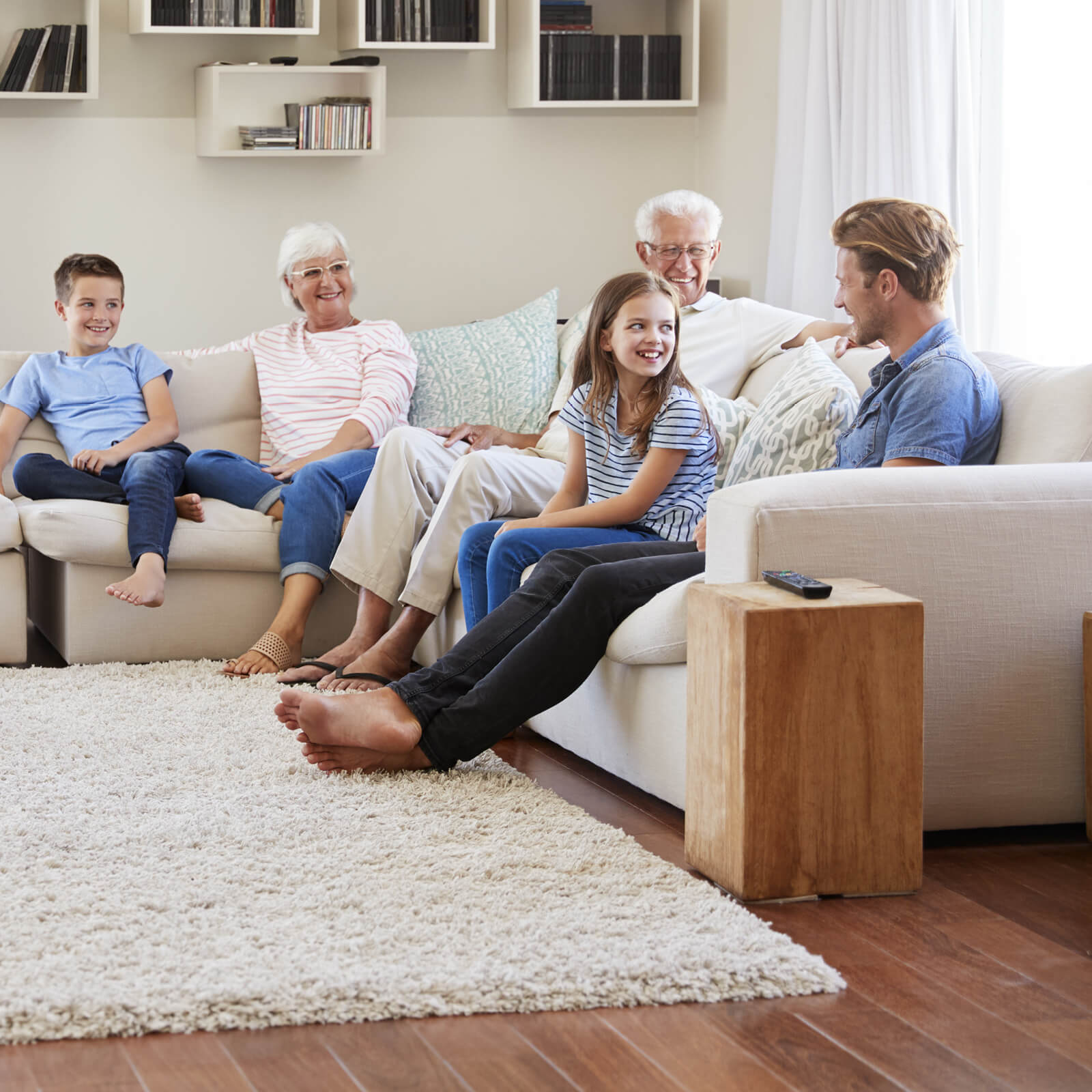 Family gosping in living room   IQ Floors